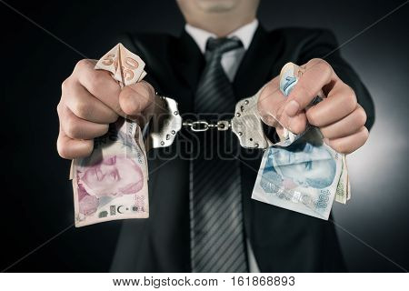 Businessman is arrested and handcuffed Turkish lira