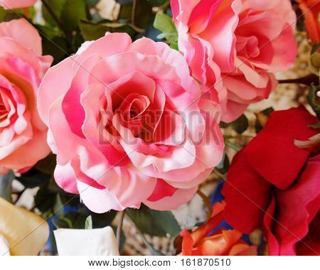 colorful dark pink fake rose flower closeup
