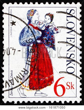 SLOVAKIA - CIRCA 2001: a stamp printed in Slovakia shows Woman and Child from Detva Traditional Costume circa 2001