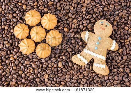 Coffee beans on wooden background are on the table top view. Concept gingerbread