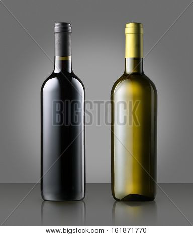Unlabelled Red And White Wine Bottles On Gray