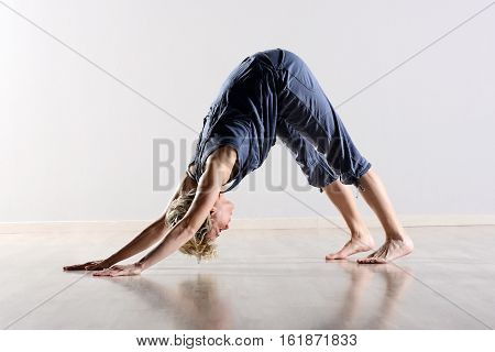 Supple Young Woman Working Out In A Gym