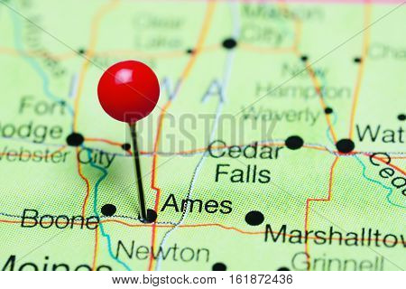 Ames pinned on a map of Iowa, USA