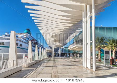 Pedestrian promenade in the port area of Malaga Andalusia Spain
