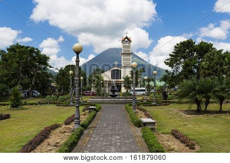 La Fortuna Costa Rica - March 31 2014: View of the town of La Fortuna in Costa Rica with the Arenal Volcano on the back.
