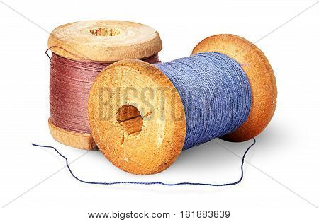 Two different colored thread on wooden spools isolated on white background