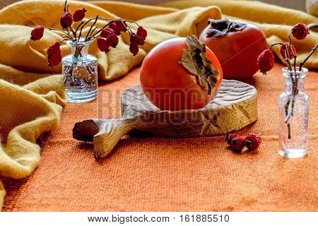 Juicy Persimmon On A Yellow Background