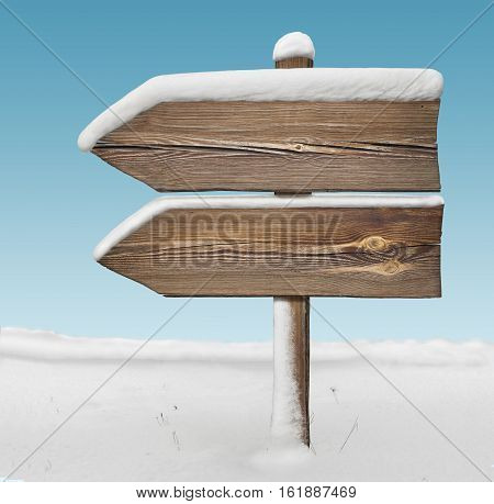 Wooden Direction Sign With Less Snow And Sky Bg. Two_arrows-one_direction