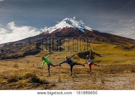 COTOPAXI ECUADOR May 2 2015: Group of tourists having fun dancing on a visit to the National Park Cotopaxi