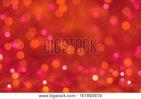 Pink bokeh holiday texture Christmas decorations background. Lights on red background. New Year Red Holiday Abstract Glitter Defocused Background. Blurred Bokeh.