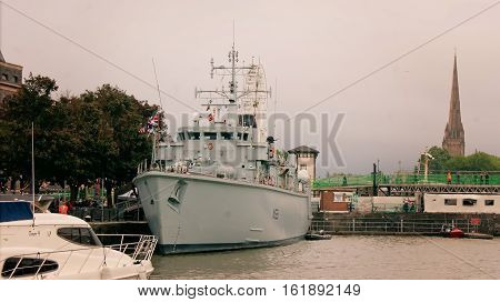 Bristol UK - July 16 2016: Minehunter HMS Atherstone moored in the Floating Harbour in Bristol during a visit to the city. HMS Atherstone a Hunt Class mine countermeasures vessel was launched in 1986 and has recently returned from a three-year deployment