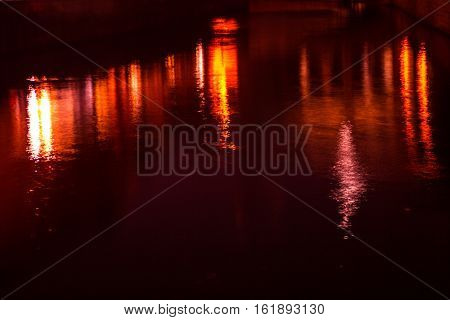 Abstract: Reflections from building lights at waters of Spree, Berlin.