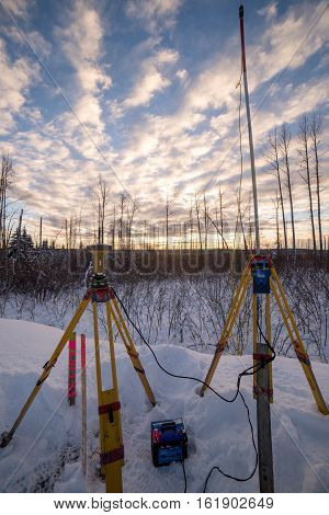 Survey equipment set up in snow at sunset canada