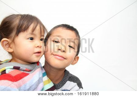 Japanese brother and sister hugging each other (7 years old boy and 2 years old girl)