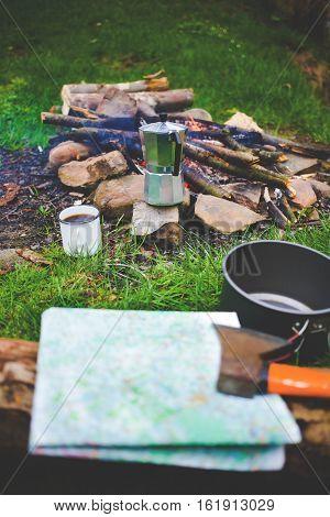 Cauldron And A Mug Near A Campfire.