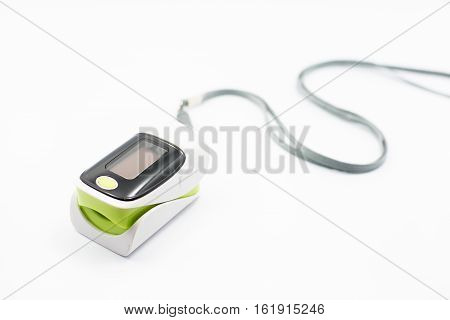 Pulse oximeter on white background. selective  focus