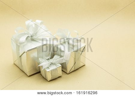 Christmas gift box isolated on gold background