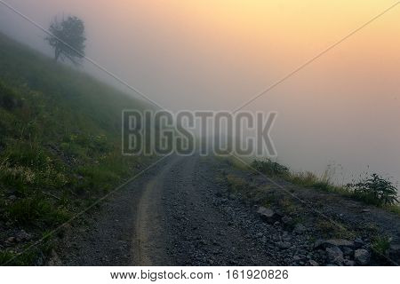 Walking in the mists of Elbrus at sunset