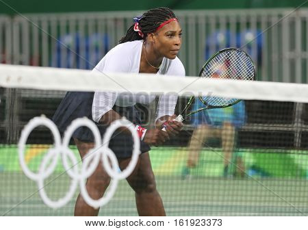 RIO DE JANEIRO, BRAZIL - AUGUST 7, 2016: Olympic champion Serena Williams of United States in action during doubles first round match of the Rio 2016 Olympic Games at the Olympic Tennis Centre