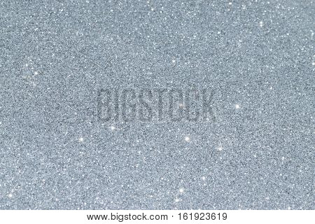 Shiny glitter background in silver color. Christmas decoration.