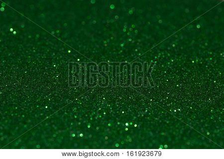 Shiny glitter background in green color. Christmas decoration.