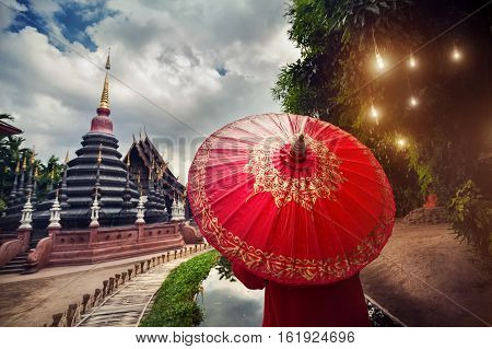 Woman With Red Umbrella In Thailand