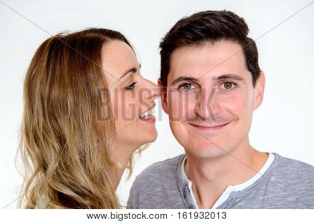 Young Woman Whisper In The Ear Of Her Boyfriend