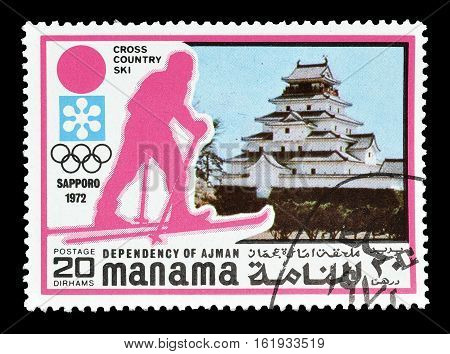 MANAMA - CIRCA 1971 : Cancelled postage stamp printed by Manama, that shows Cross country skiing.