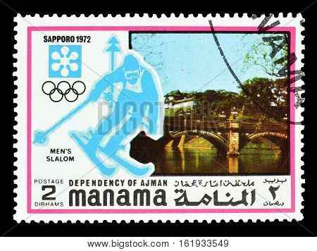 MANAMA - CIRCA 1971 : Cancelled postage stamp printed by Manama, that shows Slalom.