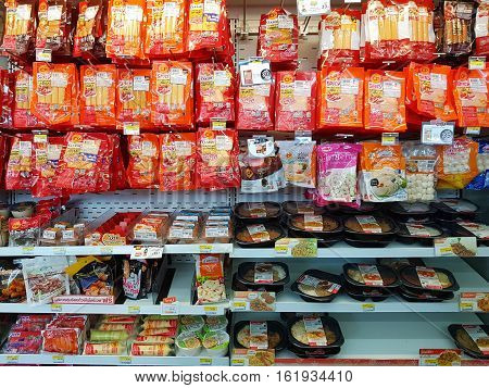 CHIANG RAI THAILAND - NOVEMBER 28: various brand of sausage products in packaging for sale on supermarket stand or shelf in Seven Eleven on November 28 2016 in Chiang rai Thailand