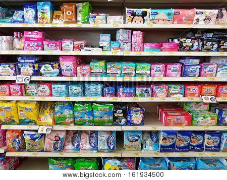 CHIANG RAI THAILAND - NOVEMBER 28: various brand of sanitary napkin in packaging for sale on supermarket stand or shelf in Seven Eleven on November 28 2016 in Chiang rai Thailand