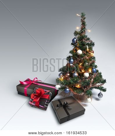 Mini Christmas Tree on gradient background with copy space and some gift box