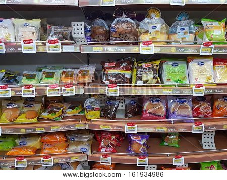 CHIANG RAI THAILAND - NOVEMBER 26: various brand of bread in packaging for sale on supermarket stand or shelf in Seven Eleven on November 26 2016 in Chiang rai Thailand.