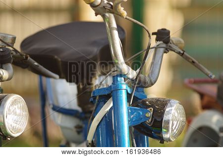 Close up of old moped of blue color
