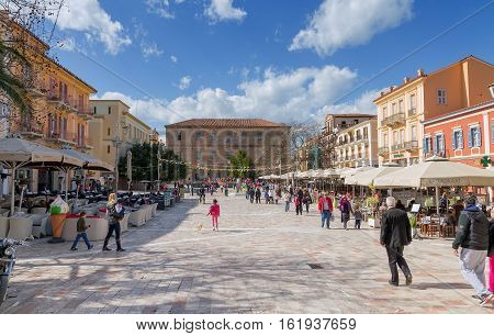 NAFPLIO, GREECE - MARCH 9: Plateia Syntagmatos (Constitution Square) on March 9, 2013 in Nafplio, Greece. Plateia Syntagmatos is the main square of the town and attracts many visitors in the weekends.