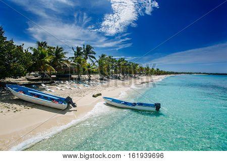 two fishing boats in Catalina island beach a desert island near Punta Cana Dominican Republic