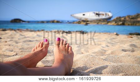 A girl sunbathes on a beach of Formentera in the Balearic Islands Spain