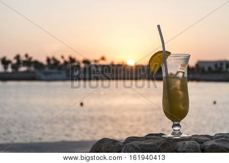 Amazing Sunset glass cocktail in Sultanate Oman at Souly Bay harbour and Hotels Oceanside