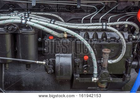 Black Diesel power engine at new tractor