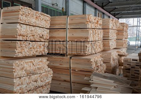 Warehouse on covered overpass: fastened sawn rectangular wooden pine sticks.