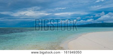 Sandy Bank on Kri Island, Low Tide, Gam in Background. Raja Ampat, Indonesia. West Papua