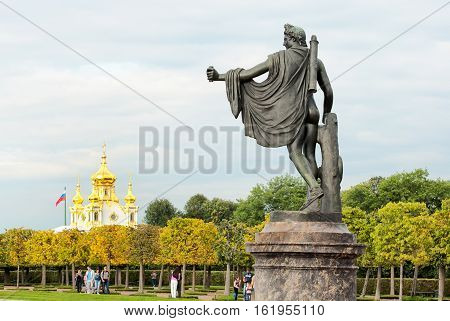 PETERHOF, SAINT - PETERSBURG, RUSSIA - AUGUST 19, 2016: The Upper Garden. Apollo Belvedere Statue. On the background is The Church of Saints Peter and Paul