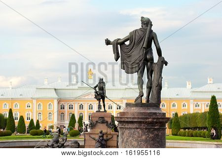 PETERHOF, SAINT - PETERSBURG, RUSSIA - AUGUST 19, 2016: The Upper Garden. Apollo Belvedere Statue. On the background is The Neptune Fountain and The Grand Palace