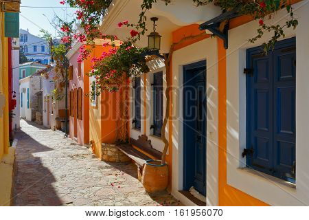 Colorful architecture in a street of Halki village, Greece.