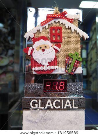 Felt Santa Claus on front of draught beer dispenser