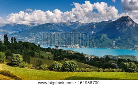 The village of Saint Apollinaire and church with Summer view on Savines-le-Lac Serre Poncon Lake and Grand Morgon (Pic de Morgon) Hautes Alpes Southern French Alps France