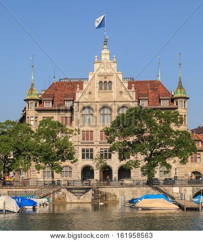 Zurich, Switzerland - 14 July 2013: the City Hall building decorated with the flag of Zurich. Zurich City Hall (German: Zurich Stadthaus) houses the administration of the city of Zurich.