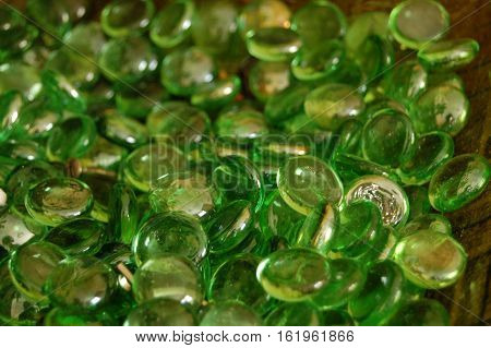 Coolourful green glass beads in a bowl