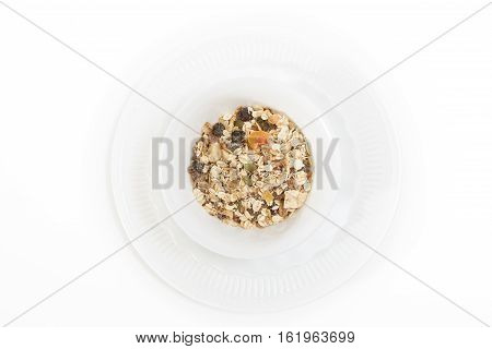 Bowl Of Muesli With Dry Fruits, On White,background.