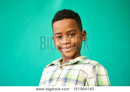 Portrait of happy children with emotions and feelings. Black young boy smiling looking at camera with joyful smile male child with glad expression on face.
